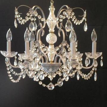 "Crystal Chandelier with 6 arms. Weight: Approx. 12 lbs Height: 24"" Width: 23"""